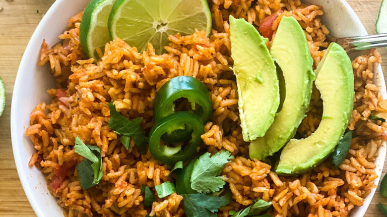 Instant Pot Spanish rice topped with slices of avocado and lime
