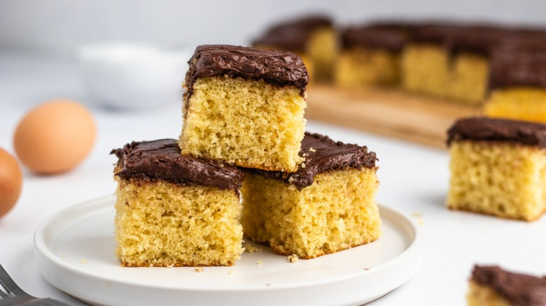 Frosted yellow cake squares on plate