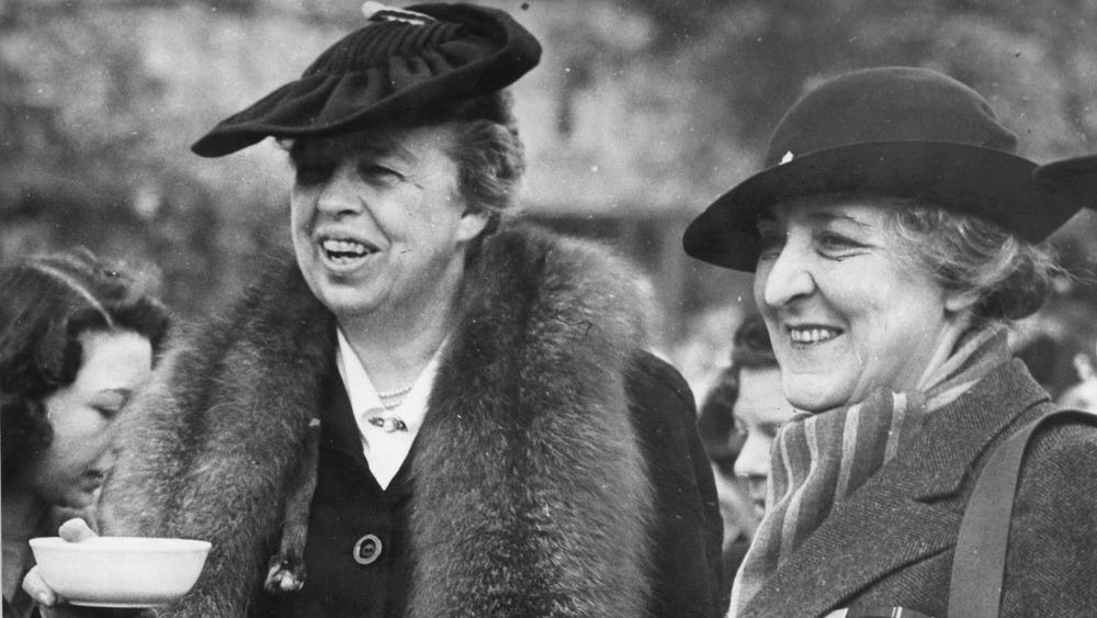 Eleanor Roosevelt taking refreshments