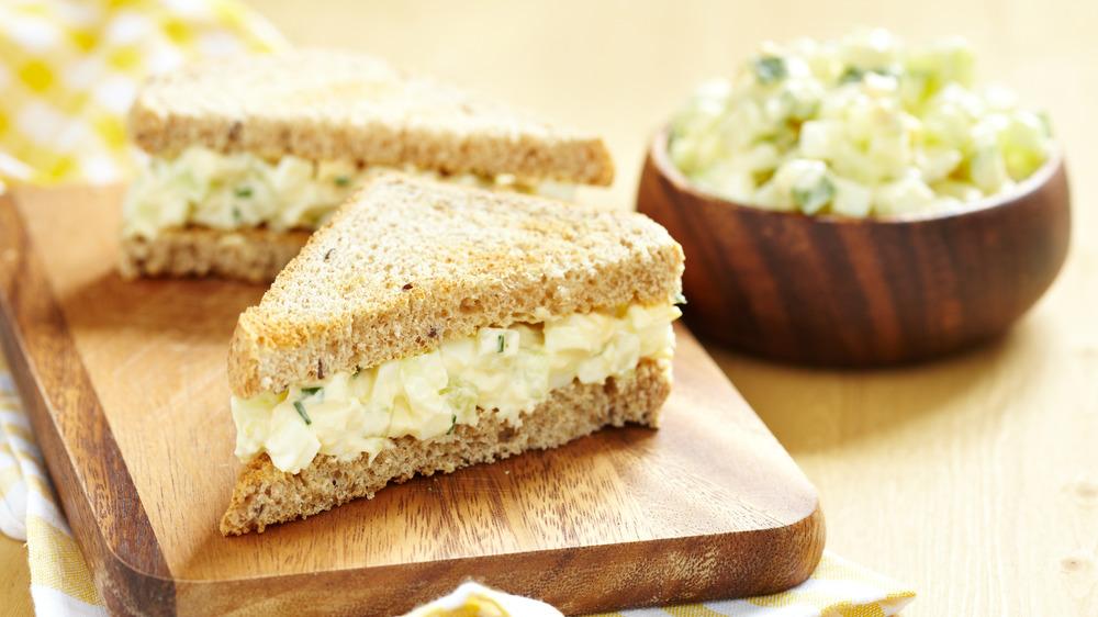 Egg salad sandwich on a board