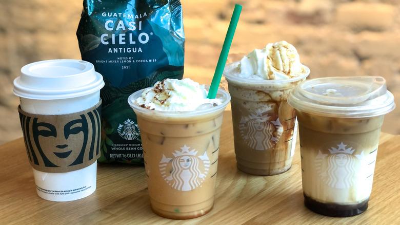 Collection of Starbucks fall 2021 drinks pumpkin spice latte and apple crisp macchiato