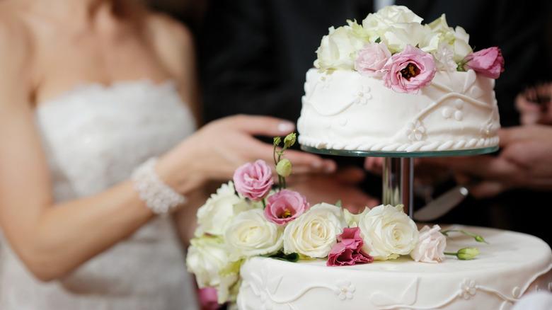 Bride cutting a wedding cake