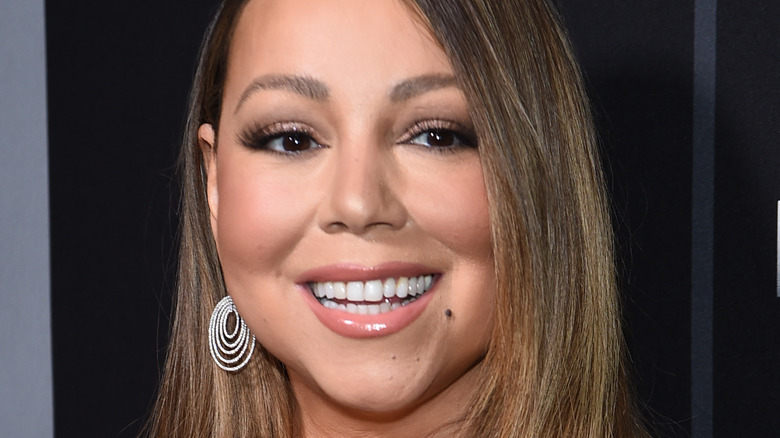 Mariah Carey smiling wide