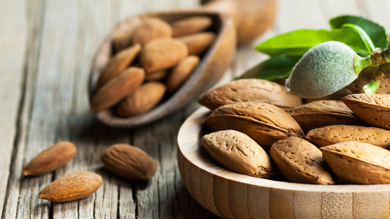 Almonds on a wooden table in a bowl