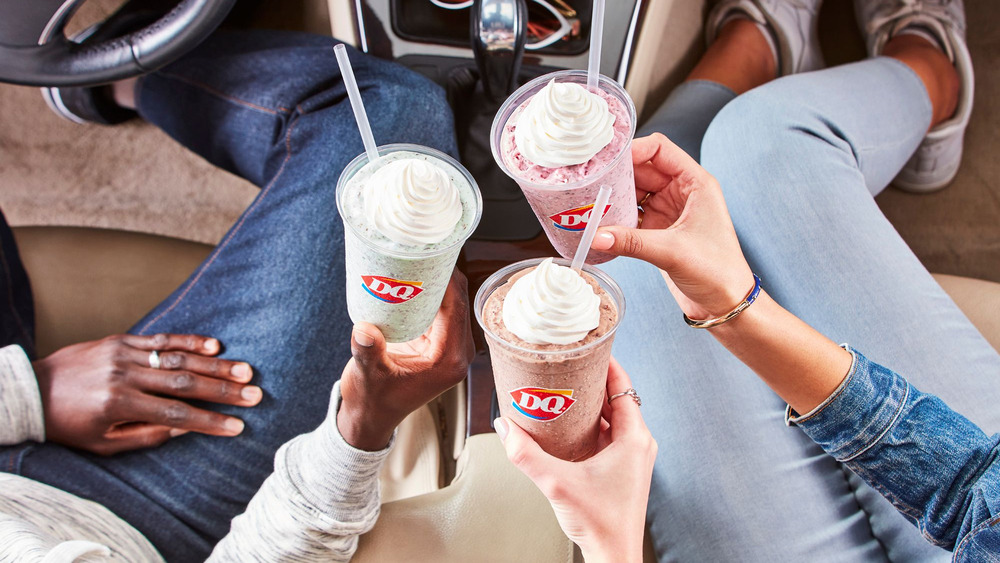 Hands holding new Dairy Queen chip shakes