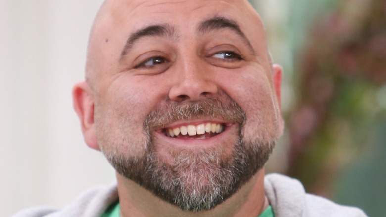Duff Goldman smiling in green tshirt