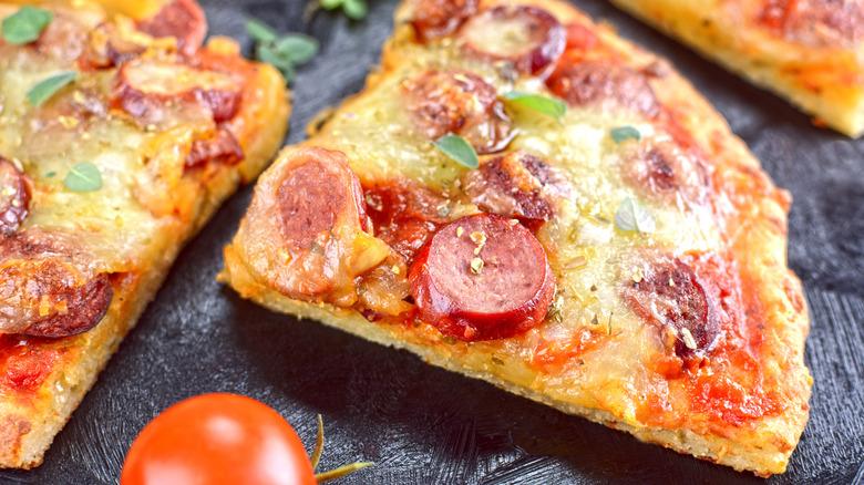 A slice of Fathead keto pizza