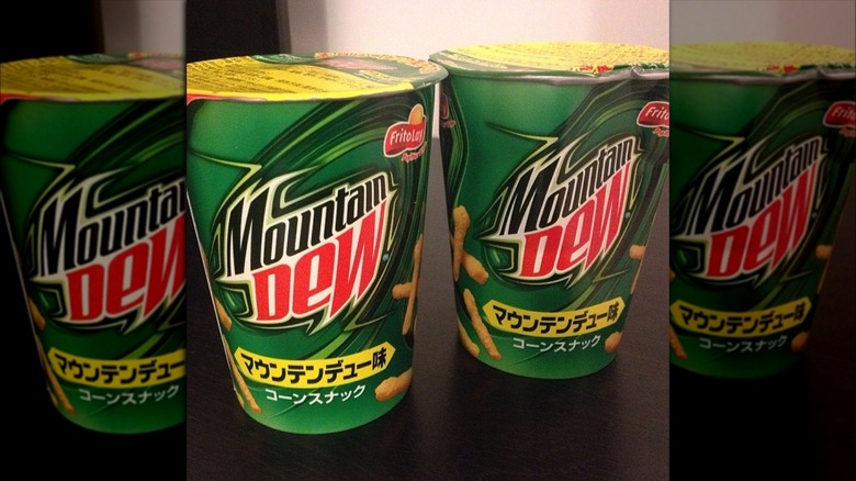 Green plastic cups with Mountain Dew Cheetos