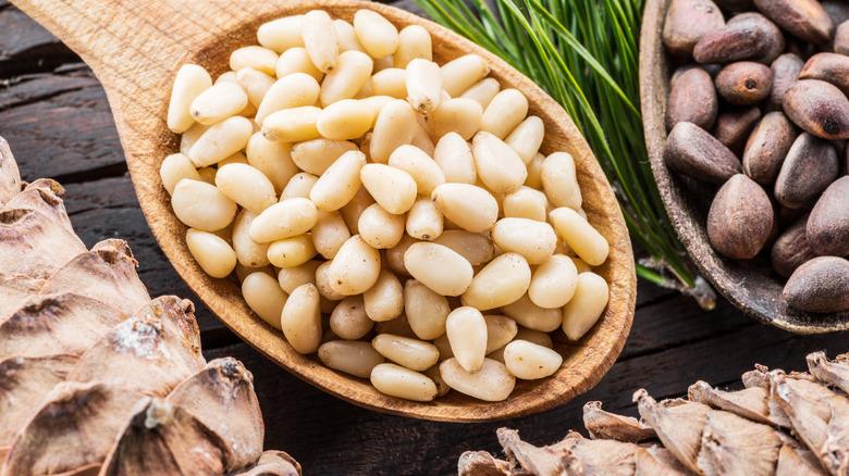 Pine nuts in wooden spoon