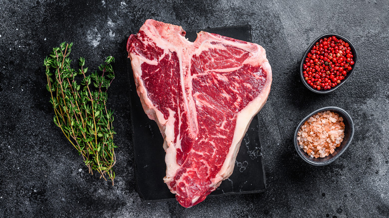 raw porterhouse steak with seasonings