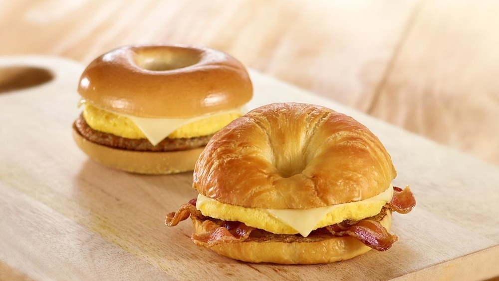 two Wawa Sizzli sandwiches on a wood table
