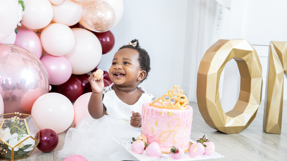 little girl with smash cake