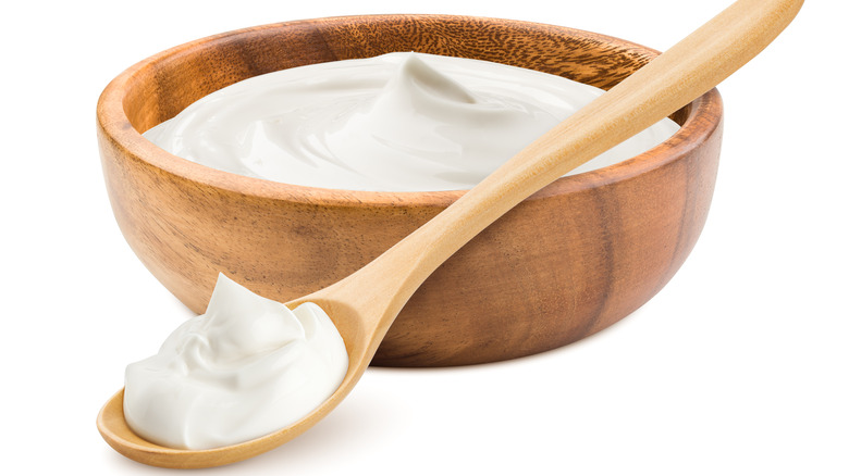 sour cream in a bowl and spoon