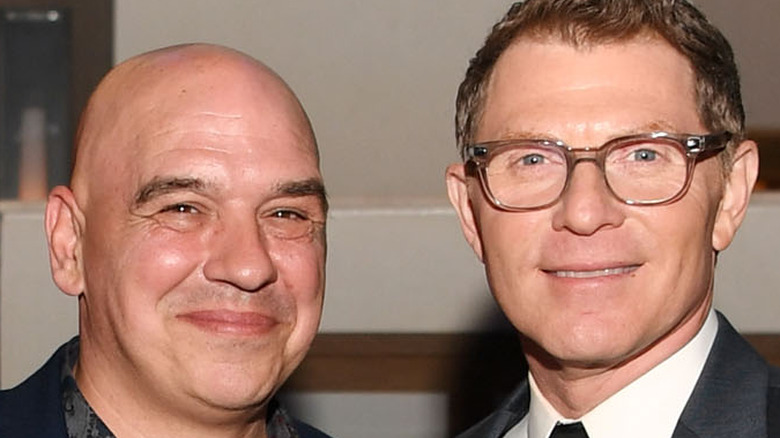 Michael Symon and Bobby Flay smiling