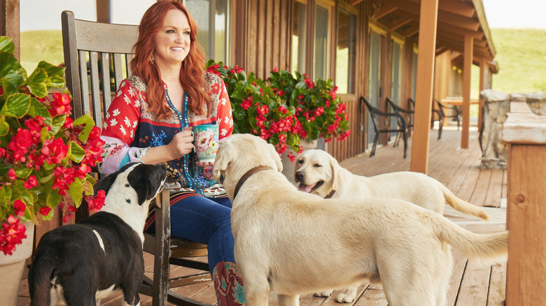 Ree Drummond sitting with her dogs