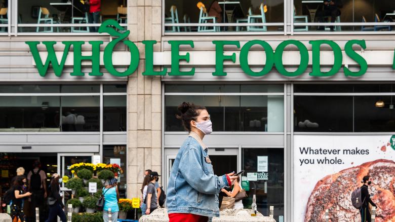 Whole Foods signage, customer wearing mask