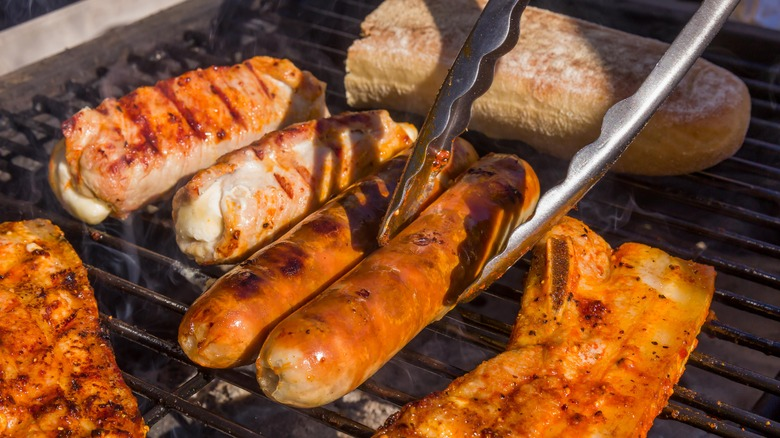 Sausages and meat on the grill