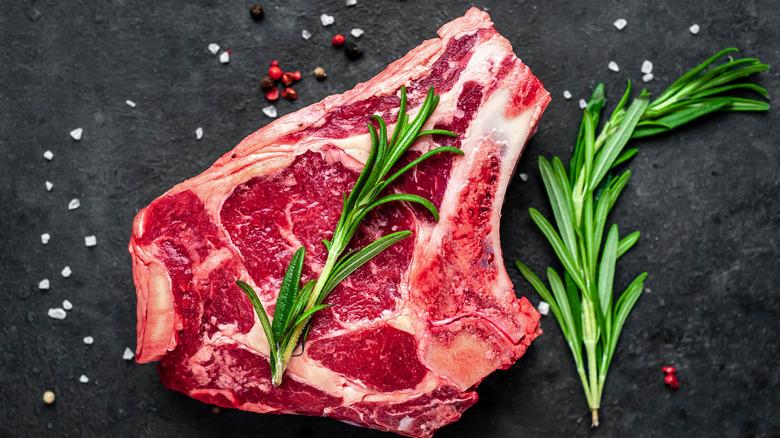 Ribeye steak with salt and seasoning