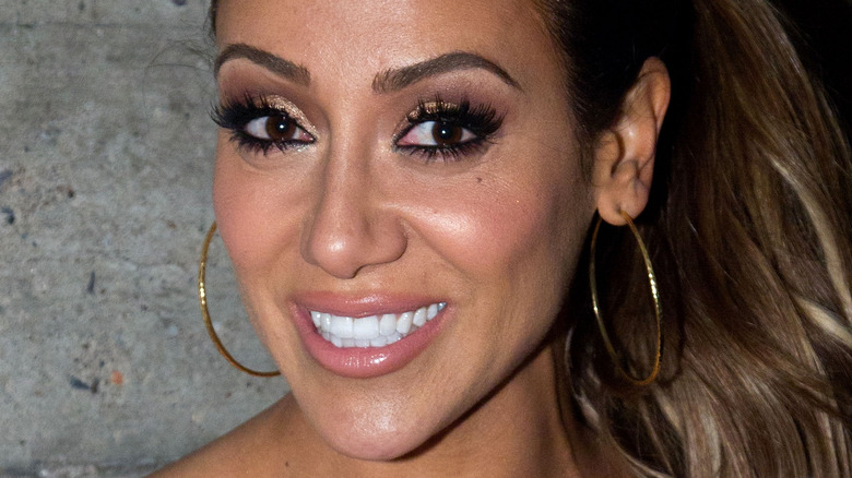 Melissa Gorga smiling from the side