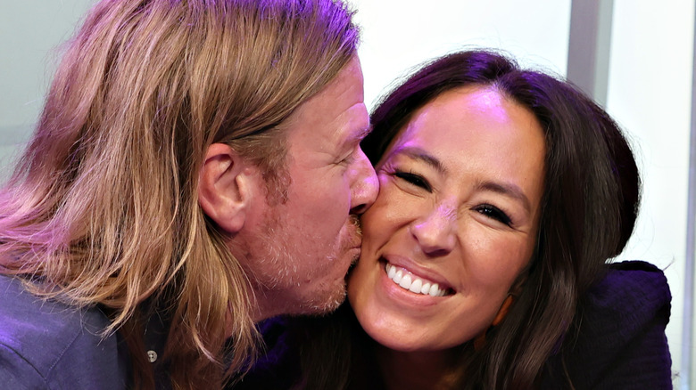 Chip and Joanna Gaines close-up kissing on cheek