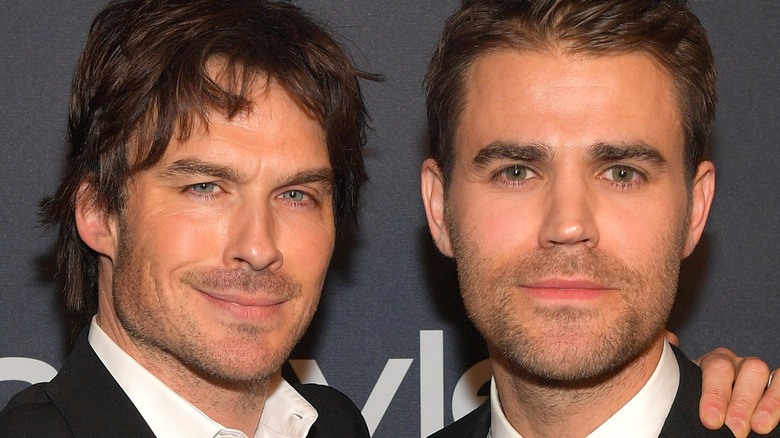 Ian Somerhalder and Paul Wesley posing at event