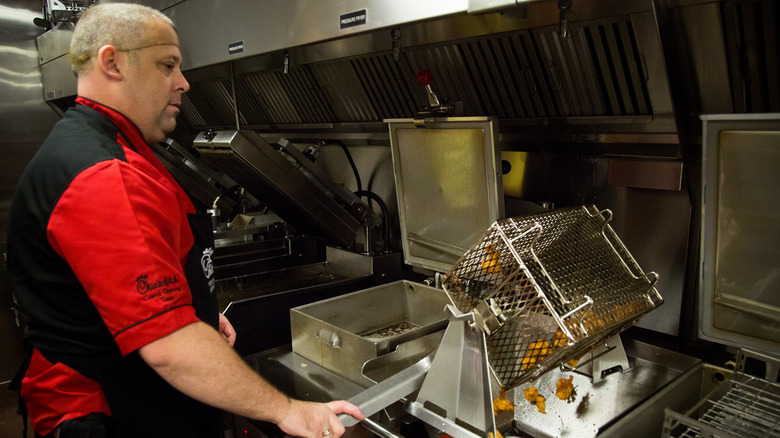 Chick-fil-a worker making nuggets