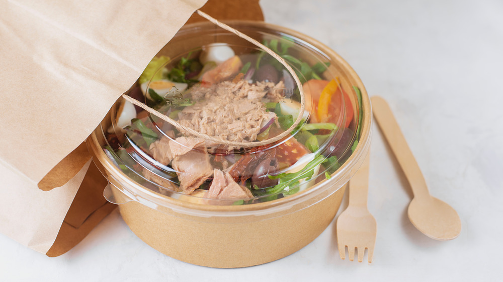 Takeout bag with container of salad