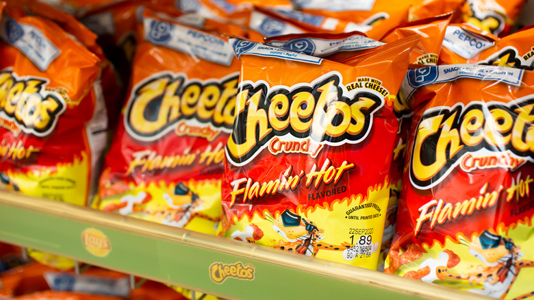 bags of flamin hot cheetos on shelf
