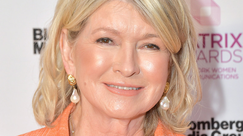 Martha Stewart smiling in orange coat