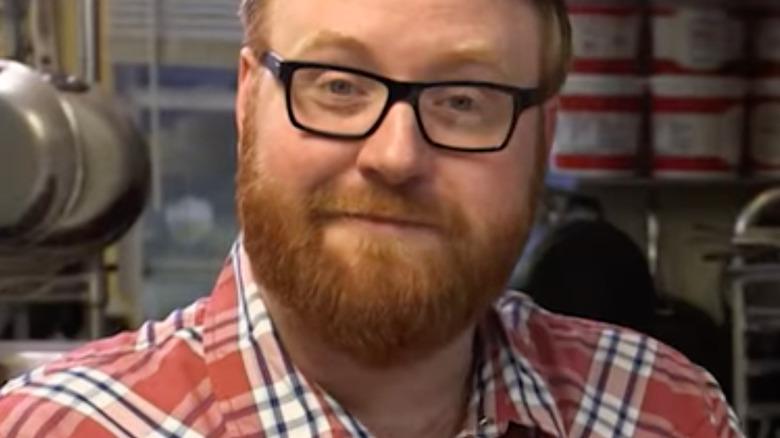 Josh Denny wearing glasses