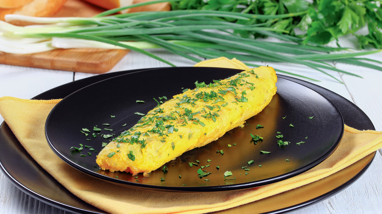 French omelet on a black plate