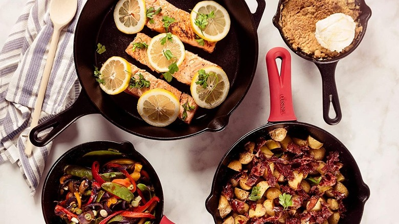 A Cuisinel cast iron skillet set with food