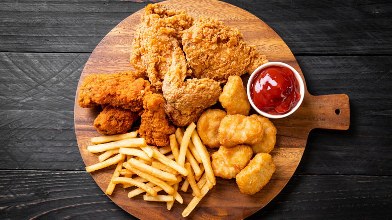 French fries with fried chicken and chicken nuggets