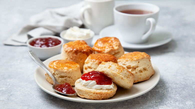 Scones and jam assorted on white plate
