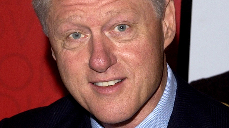 Former president Bill Clinton smiling at event