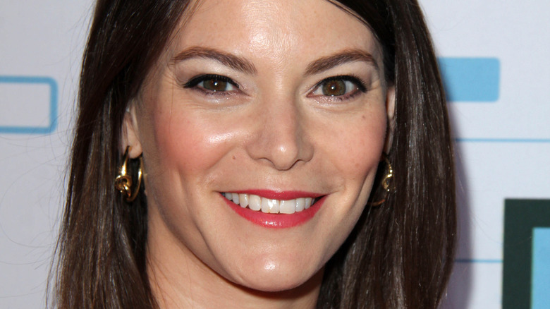 Gail Simmons smiling on red carpet