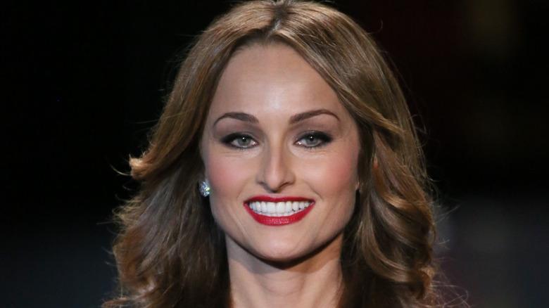 Giada De Laurentiis wearing red lipstick and earrings