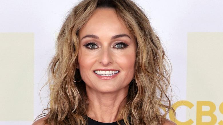 Giada de Laurentiis smiles with curly hair