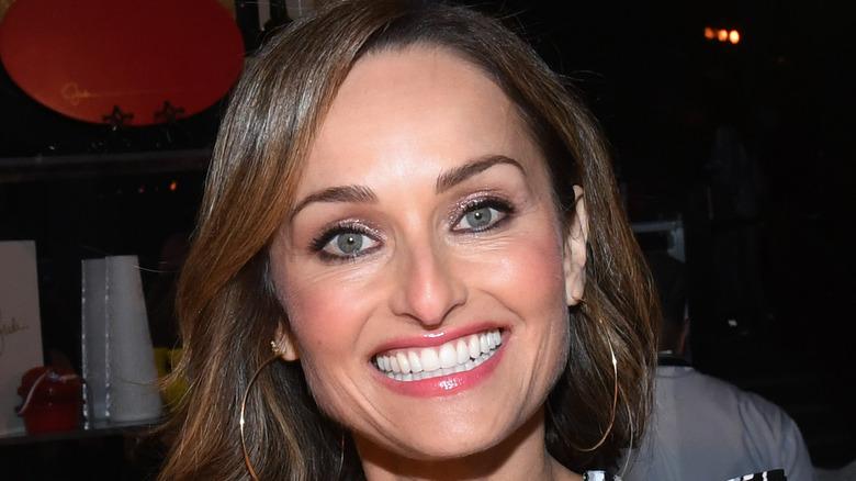 Giada De Laurentiis smiling, wearing hoop earrings
