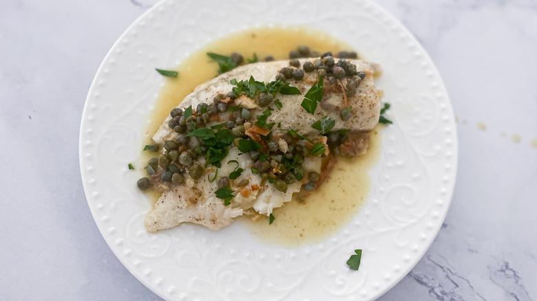 tilapia piccata on a dish