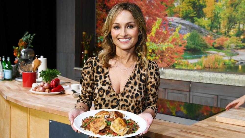 Giada De Laurentiis smiles with platter of chicken