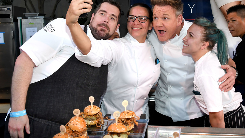 Gordon Ramsay and his chefs take selfie in front of hamburger display