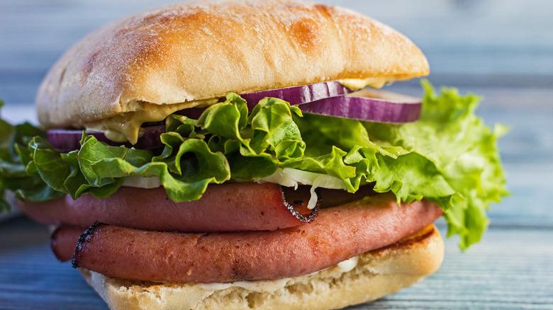 Bologna sandwich with lettuce and ciabatta bread