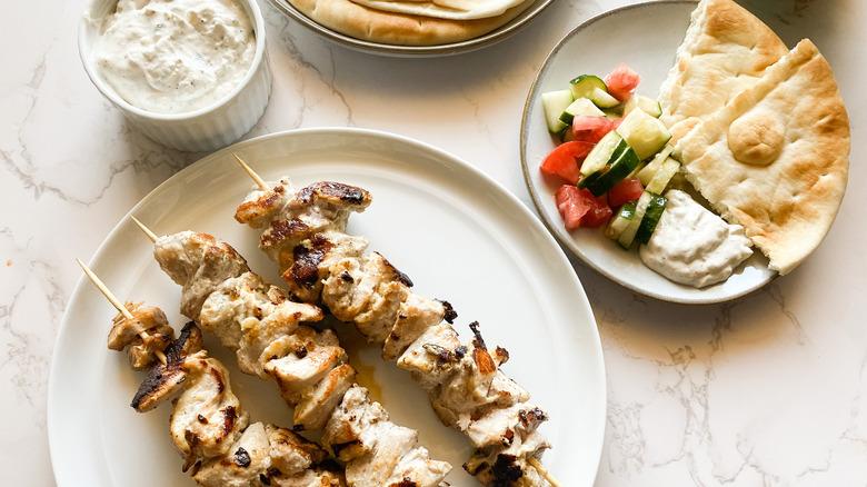 Greek Chicken Souvlaki skewers served on platter
