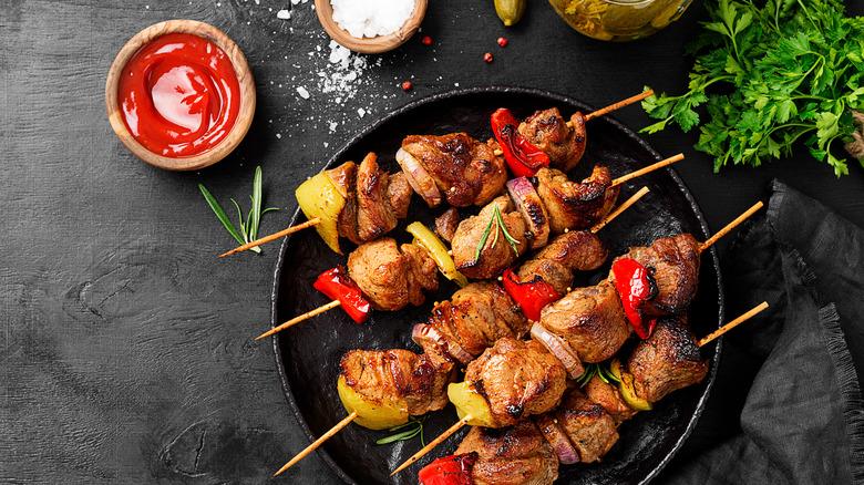Kebabs on a black plate