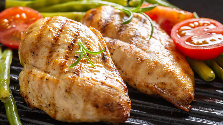 Chicken breasts on grill