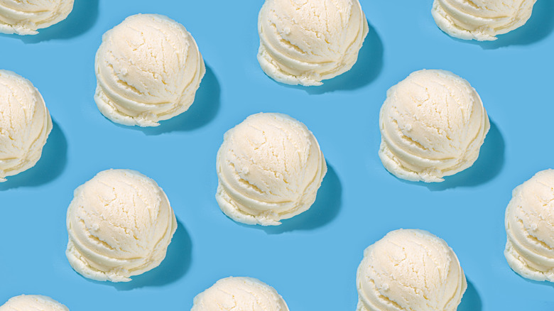 Scoops of vanilla ice cream on a blue backdrop