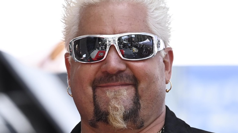 Guy Fieri with silver sunglasses on