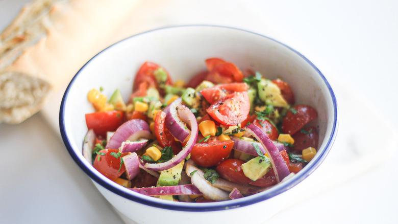 Avocado tomato salad in bowl