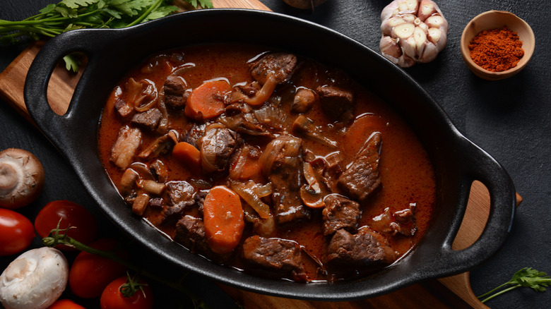 beef bourguignon with carrots and mushrooms in a pot